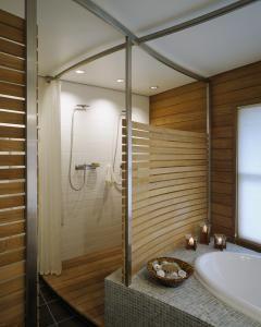 dual shower stall with wooden slat wall | zen bathroom