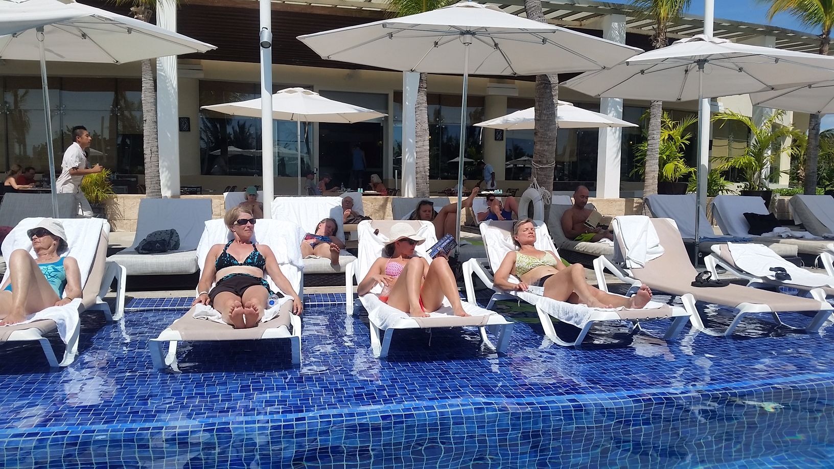 Pool loungers at Grand section