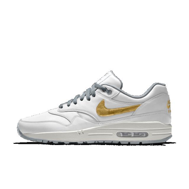 Customised Nike Airs metallic gold swoosh, white mains
