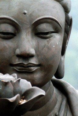 Here a statue shows buddha meditating with a lotus flower in front the buddhism lotus flower symbol represents an unfolding and new awakening to the spiritual realms mightylinksfo Choice Image