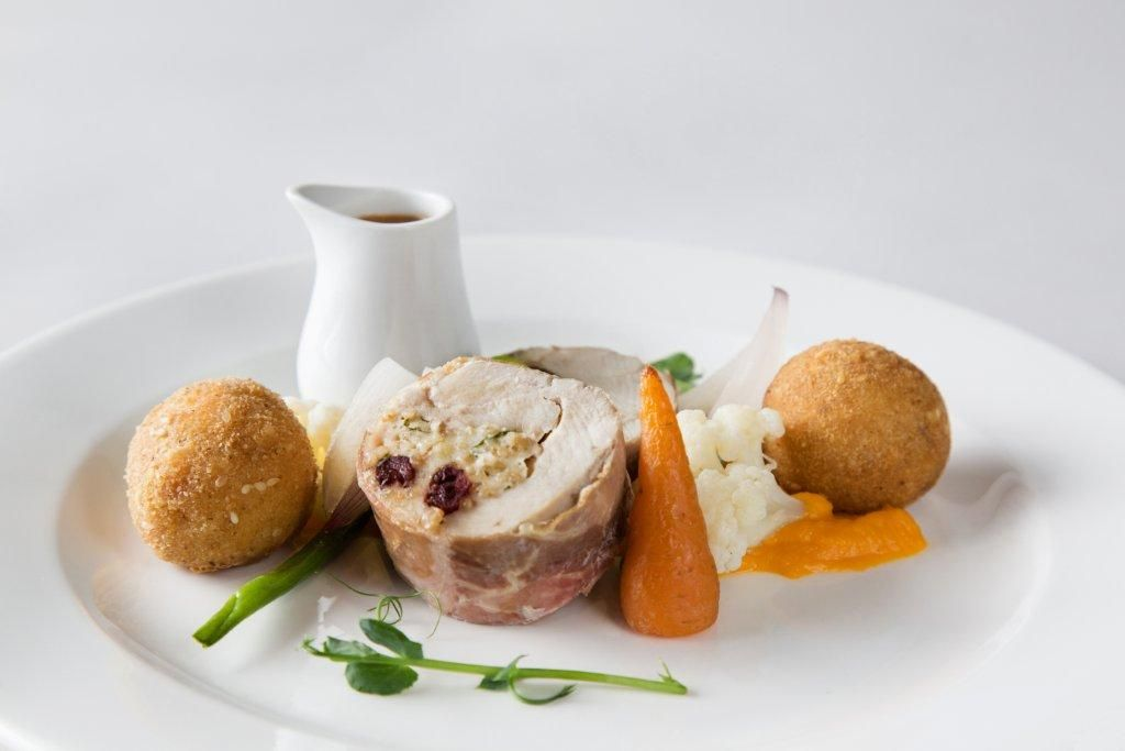 Ayrshire chicken roulade baked with cranberry, oatmeal and parsley served with creamed pumpkin, a medley of little vegetables, 'nuts and seeds' tatties and a wine jus - by Heritage Portfolio