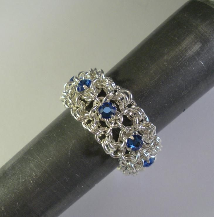 A simply elegant eternity ring made from Venus in Chains� delicate Chain Maille Ribbon Pattern, using genuine Swarovski Crystal Rose Montees and lots of silver toned round jumprings. This pattern might be my most intricate yet with even more, even smaller jumprings! This beautiful ring is even reversible with clear white crystals on one side and Sapphire Blue on the other.