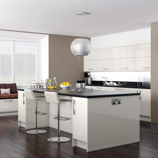 White Kitchen With Taupe Walls Cabinetry Island Unit And Black Worktops