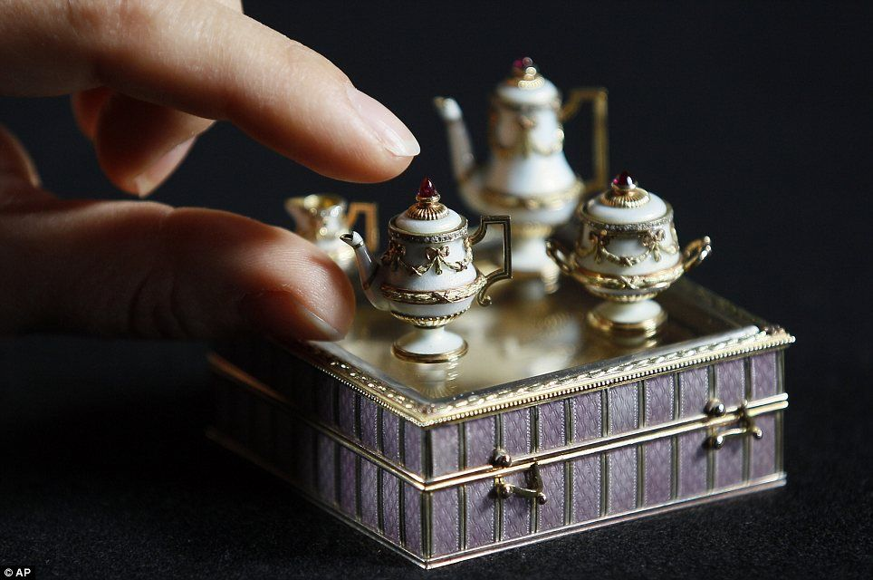 A miniature Fabergé tea set that is among more than 100 items collected by the Royals since the reign of Queen Victoria