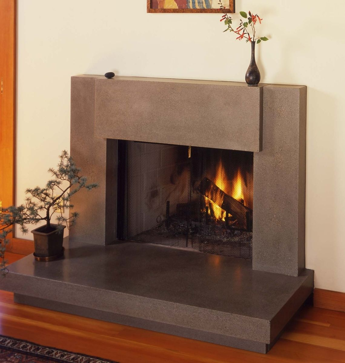 Contemporary Polished Concrete Fireplace Surround