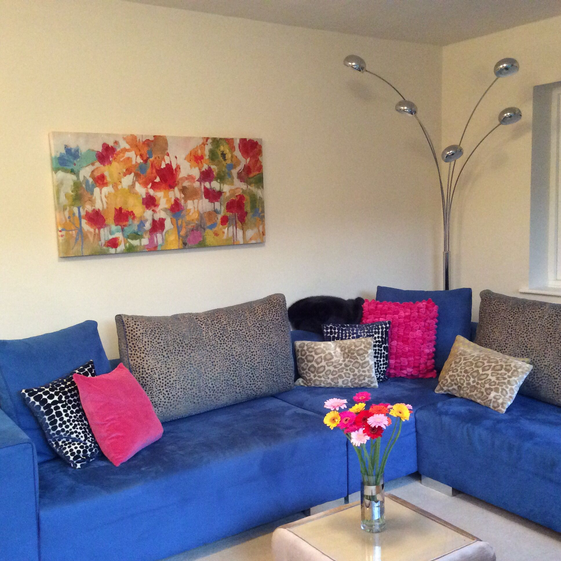 Blue corner sofa with pink cushions House ideas