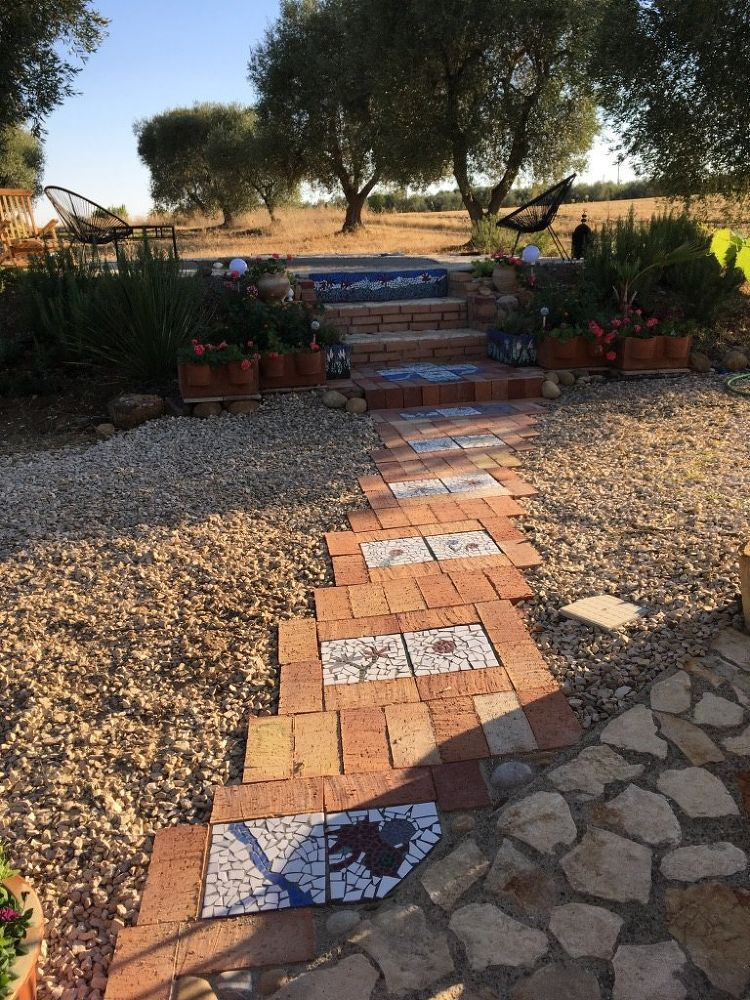 Homeowner Collects Broken Tiles And Ugly Pavers Look At Her Incredible Backyard Walkway Now