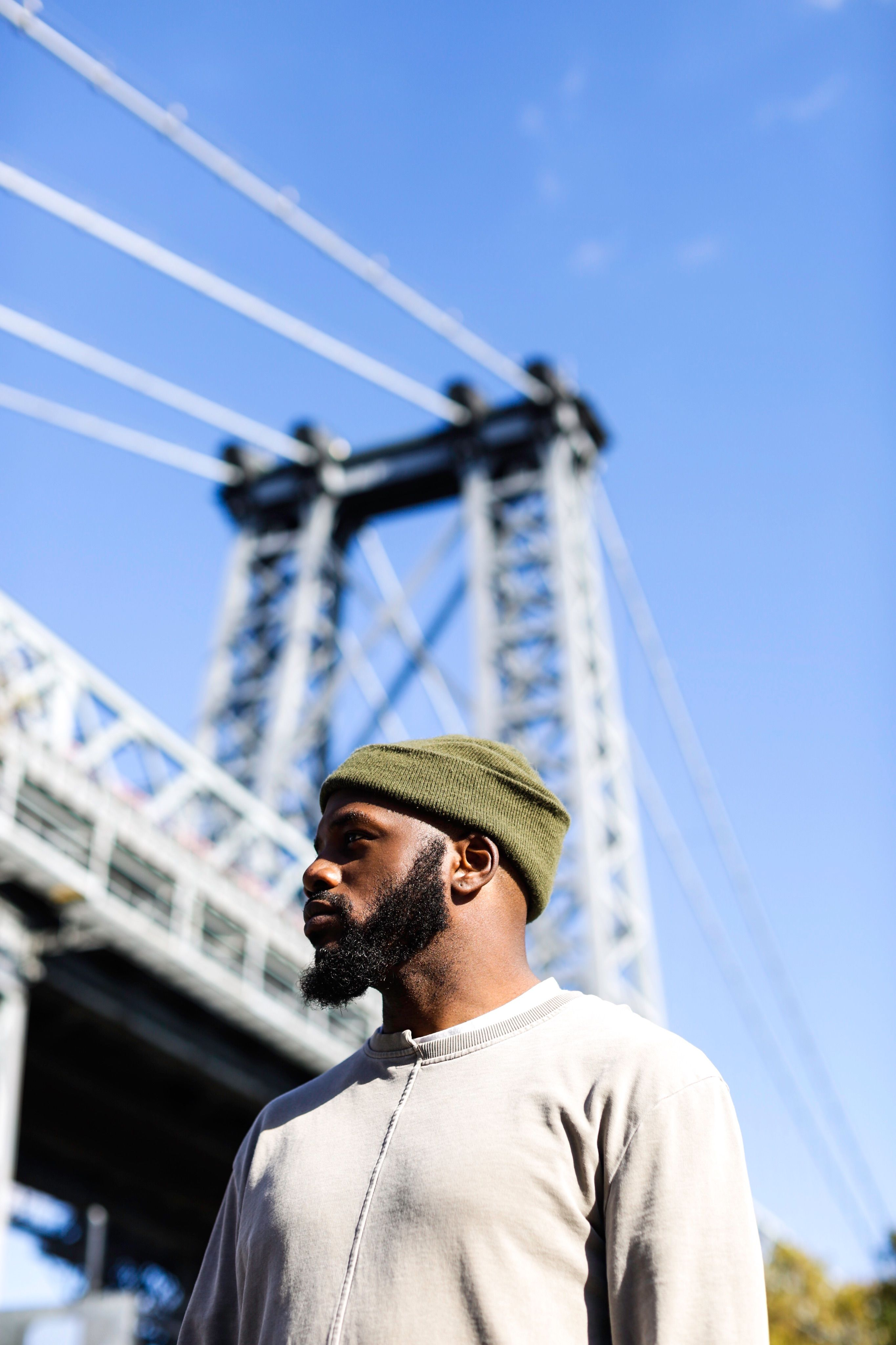 Under Williamsburg Bridge portrait with a black beard ...