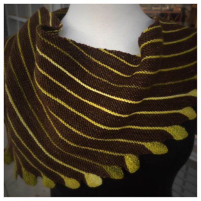 The shop's WIP of Marina Behm's Leftie is finally completed. The shawl was knitted with one skein of Knitted Wit's Victory Fingering and one box of their gradient Sixlets.