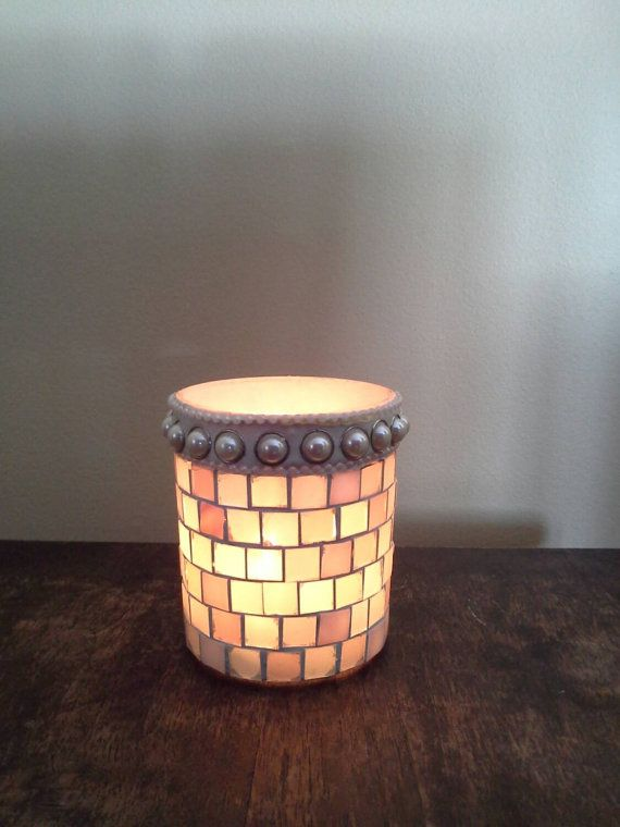 Check out this item in my Etsy shop https://www.etsy.com/listing/225759620/stained-glass-mosaic-tealight-candle