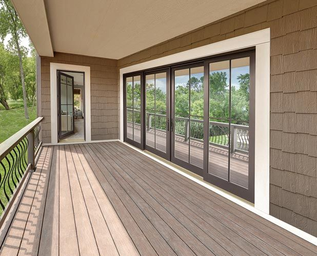 Four Panel Sliding Door with Simulated Divided Lite Exterior. Live near Glen Ellyn IL? Call Ultimate Home Solutions for a free in-home estimate for Marvin ... & Four Panel Sliding Door with Simulated Divided Lite Exterior. Live ...
