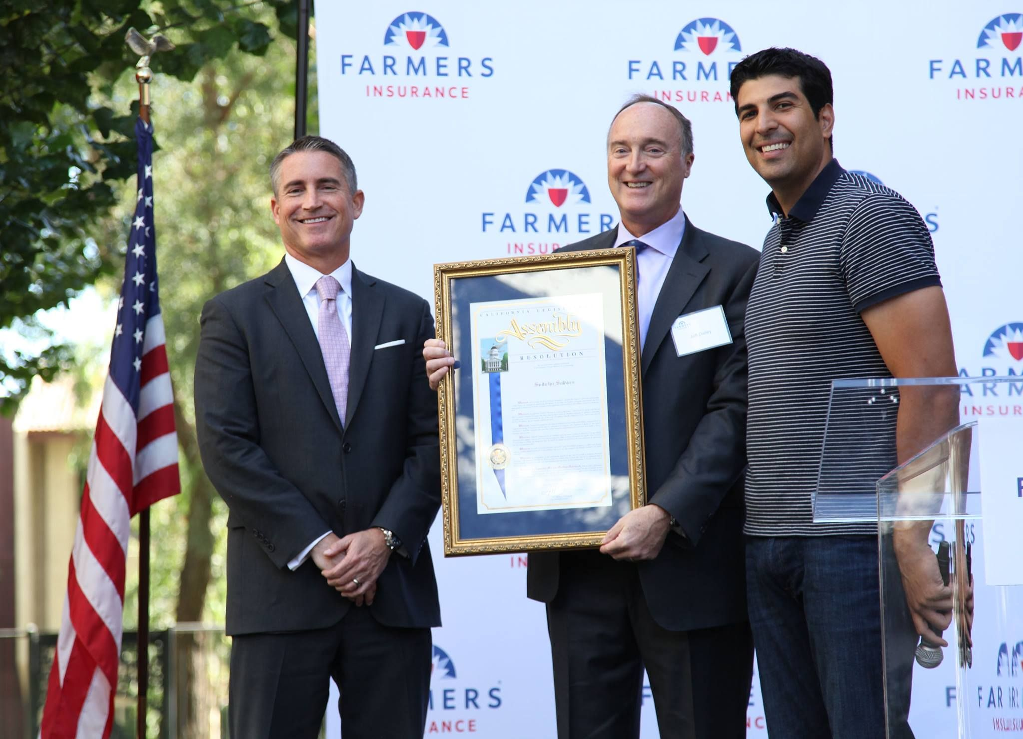 Farmers Insurance CEO Jeff Dailey and Los Angeles Deputy