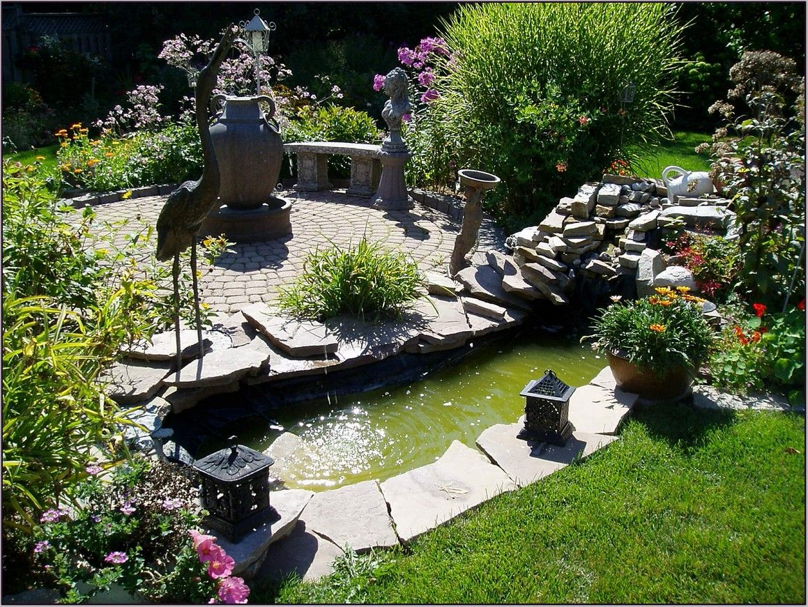 backyard landscaping design with small fishpool gardening