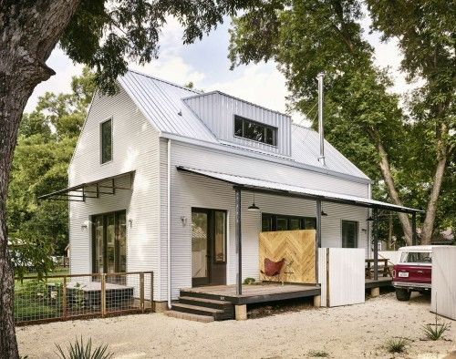 modern farmhouse design white corrugated metal siding clads