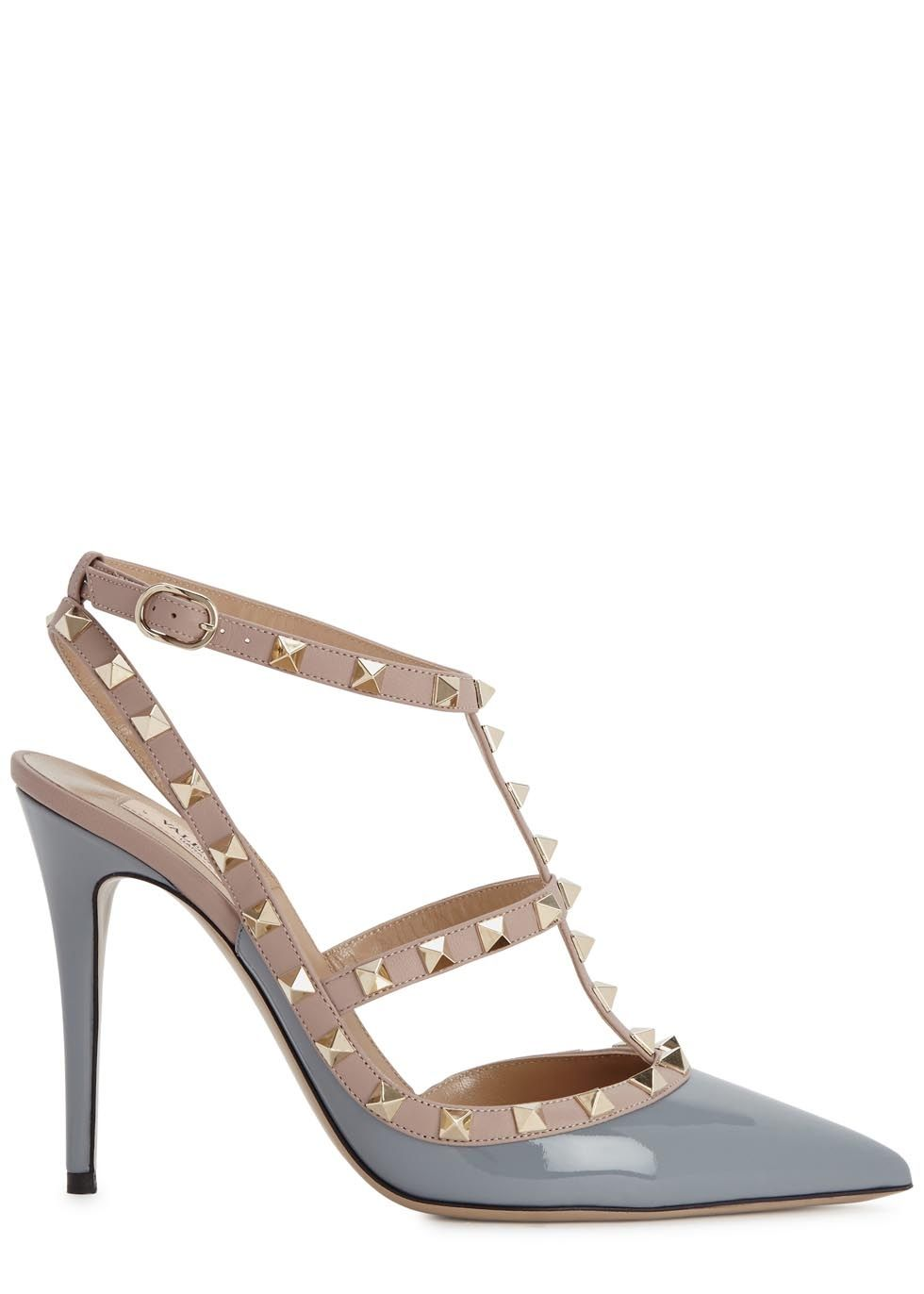 beb60d911b9 Valentino grey patent leather pumps Heel measures approximately 4 inches   100mm Pale gold stud embellishments