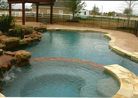 The Pool Was In A Modern Oblong Shape And Also Contained A Rock