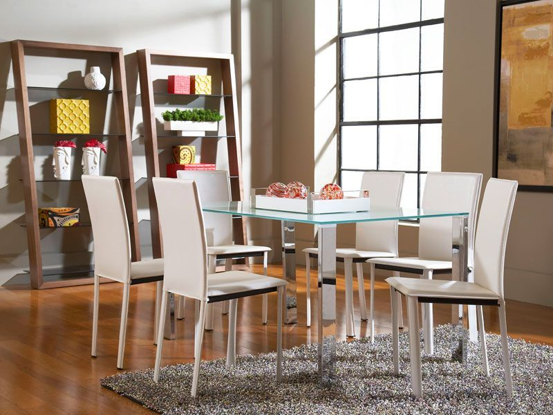 Sleek white dining room chairs - great contemporary style.