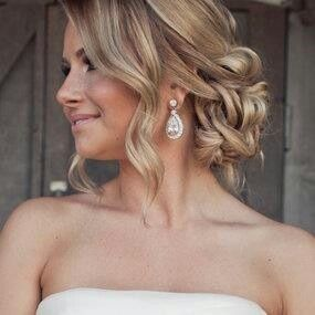 Loose Curls And Romantic Messy Bun Also A Wedding Idea