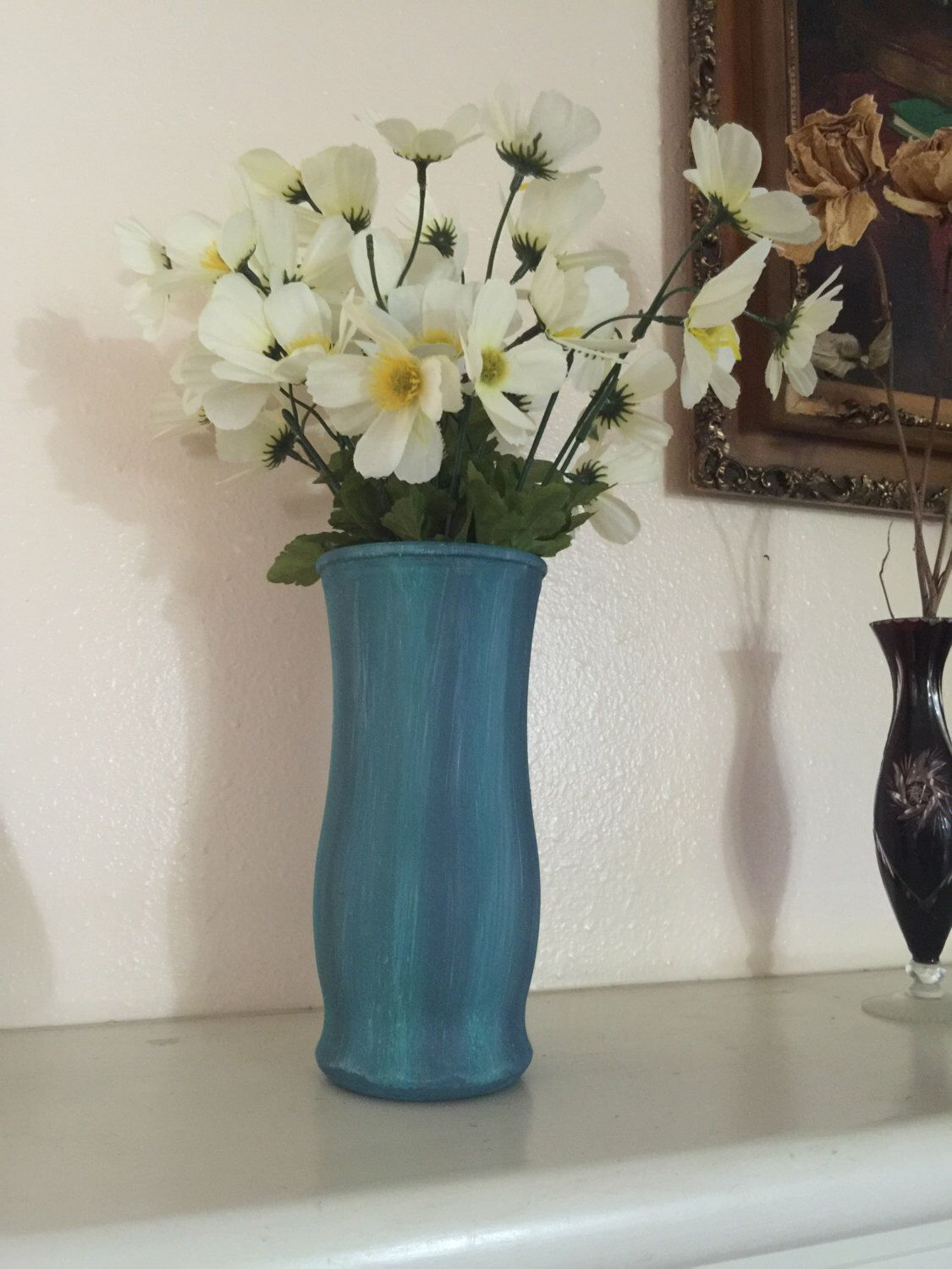 A personal favorite from my Etsy shop https://www.etsy.com/listing/481025835/teal-and-blue-hand-painted-glass-vase