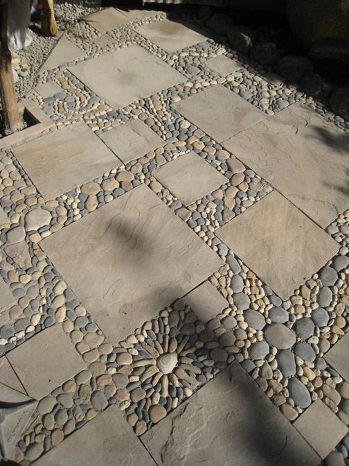 Beautiful patio or floor made of stone and pebbles