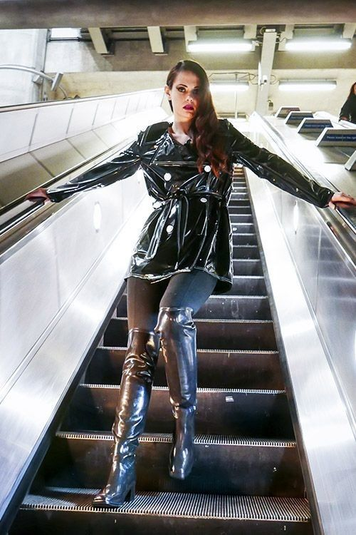 Pvc Raincoat And Otk Boots On Escalator Vinyl Clothing