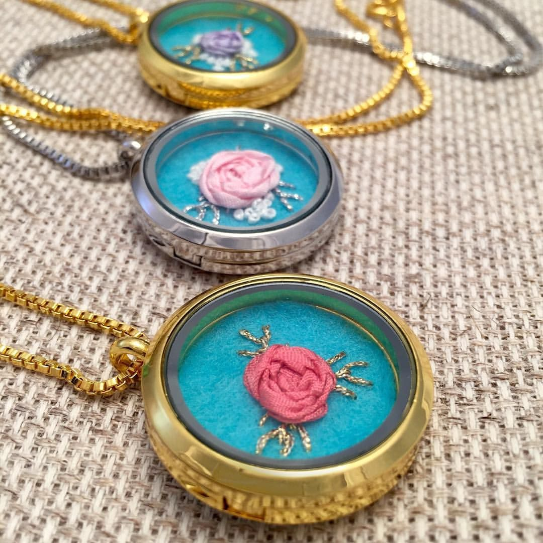 All these beauties are up in my shop! I have a wide range of silk ribbon rose necklaces and several CUSTOM listings. I can whip up a rose necklace in any color combination. Click the link for my Etsy shop in my profile.