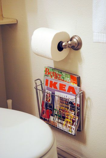 Elegant Wall Mounted Magazine Holder Under Toilet Paper Holder To Maximize Space In  A Small Bathroom.