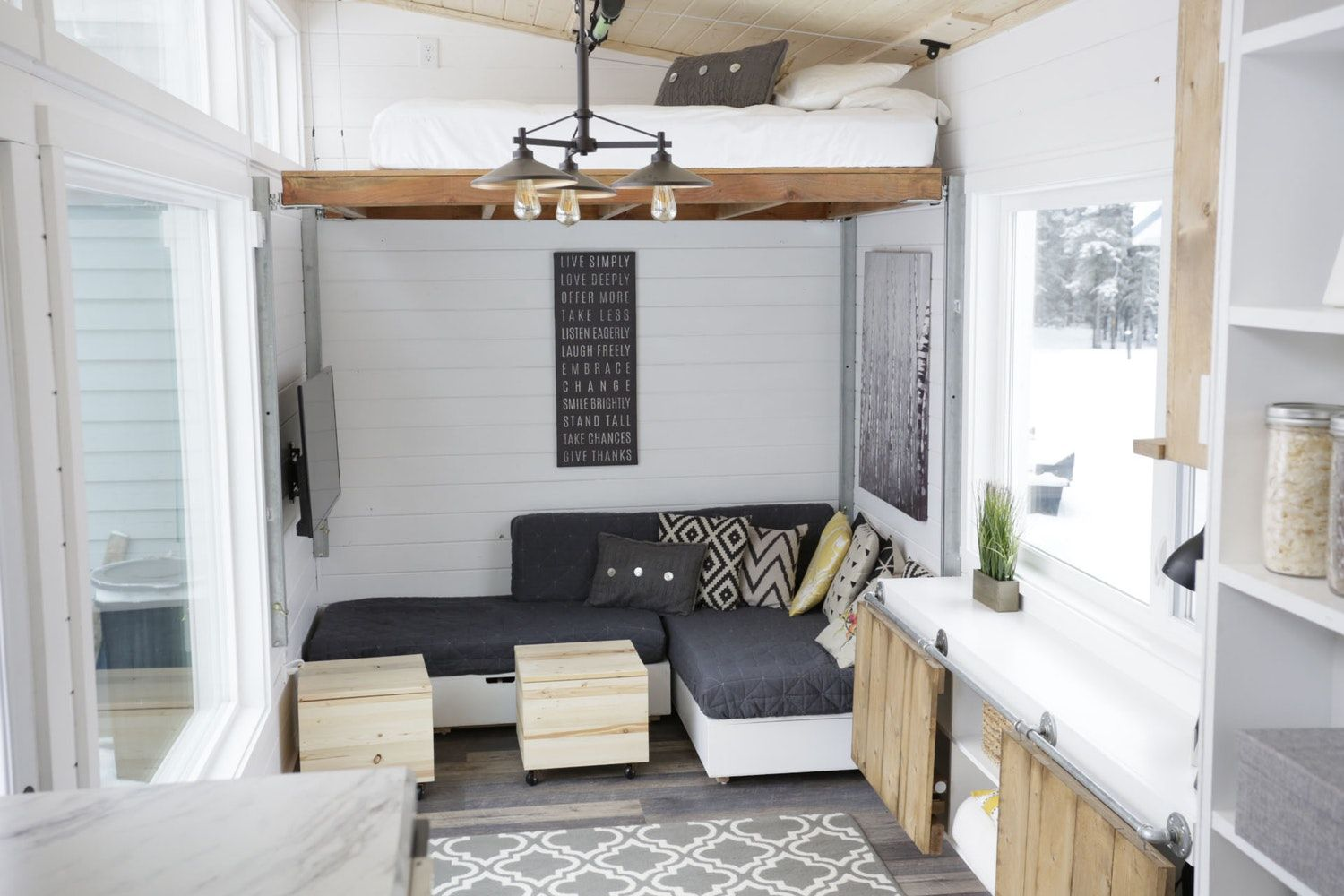 A Tiny House With A Unique Clever Bedroom Solution Modern Tiny House Tiny House Storage Tiny House Furniture