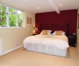 photo of beige maroon plum red white bedroom with feature wall colour idea - Red White Bedroom Designs