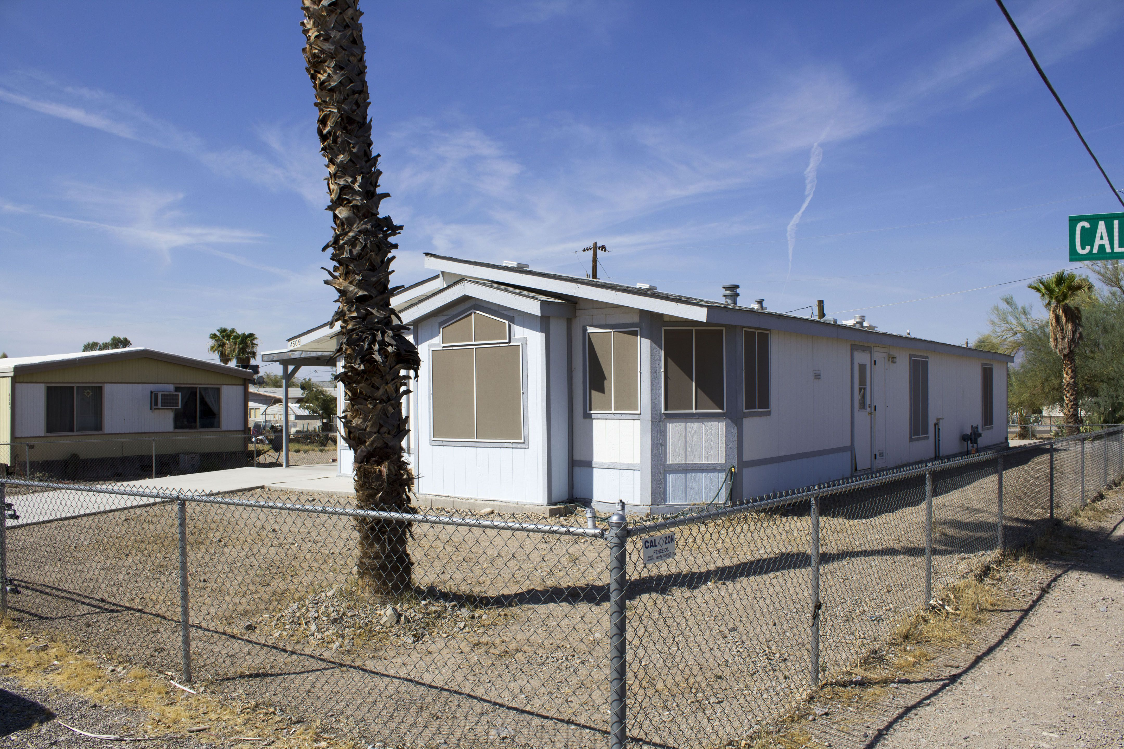 3 bedroom, 2 bath manufactured home on large corner lot in Fort Mohave, Arizona with easy access to Hwy 95, close to shopping, the Colorado River and the Avi Resort and Casino in Laughlin, NV.  4505 Calle Esperanza, Fort Mohave, AZ 86426 $75,000