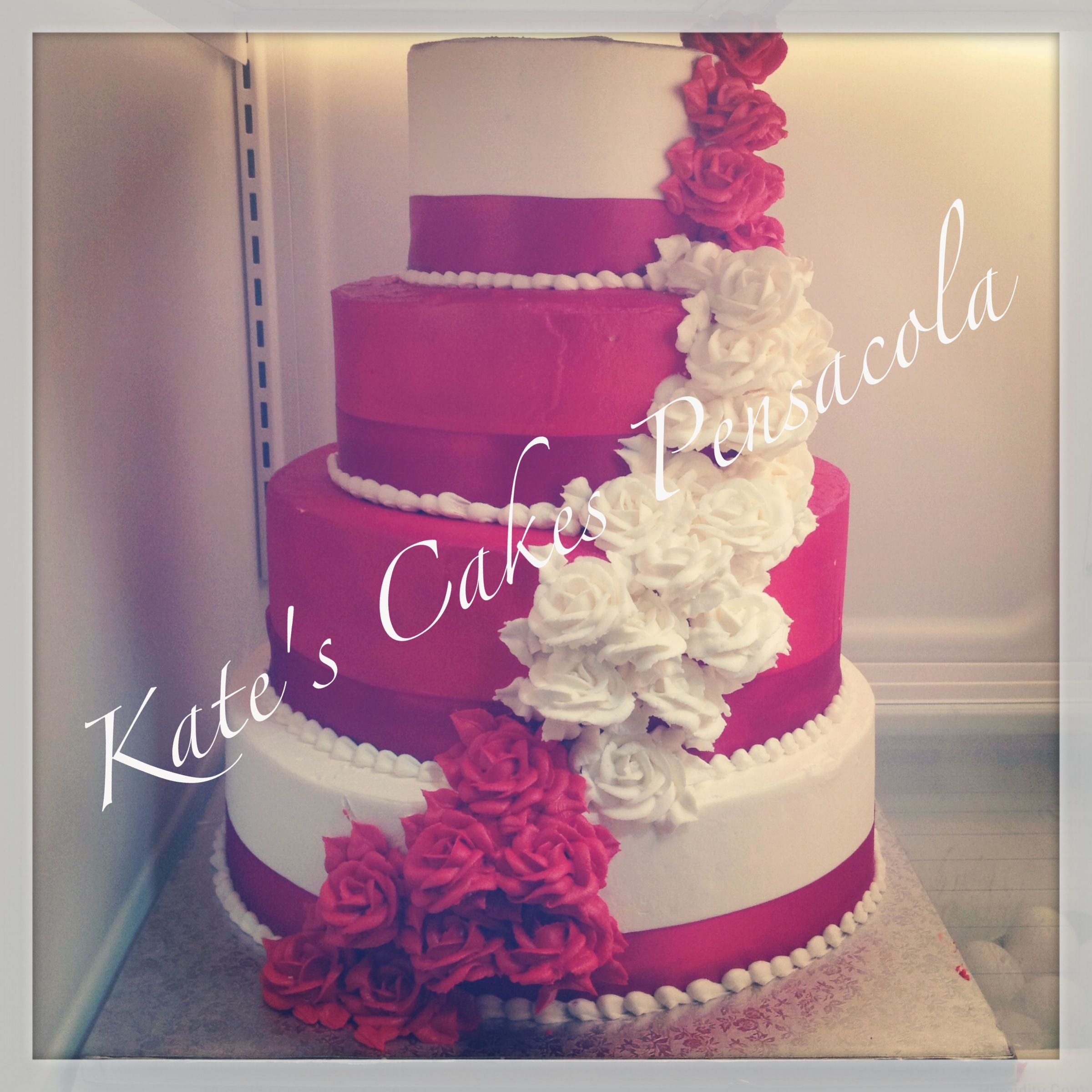 Red and white wedding cake. Cascading roses. All buttercream ...