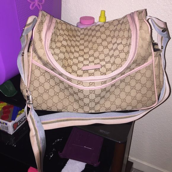 44c49a3f360 Authentic Gucci Diaper Bag This beautiful pink and blue canvas diaper bag  is in preowned condition