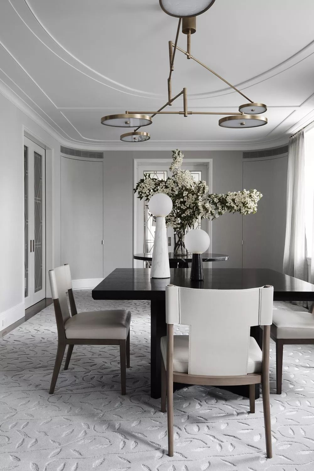 Modern ceiling light appears to be a warm brass tone interiors