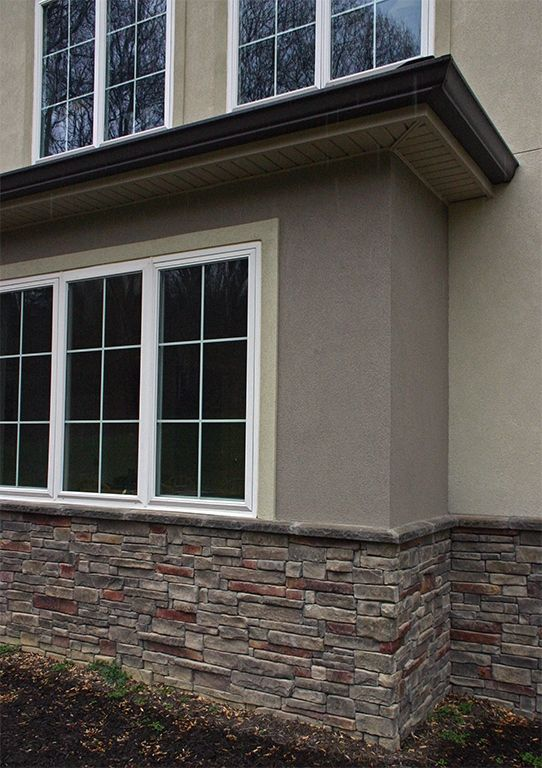 Detailed exterior stone wainscot am cor inc ferrocement for Stucco facade