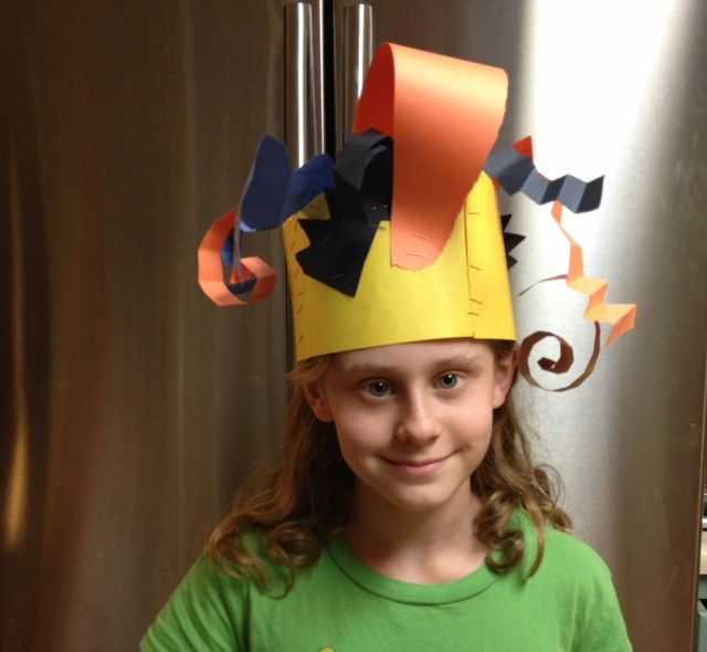 Kid designed and made. Construction paper hat.