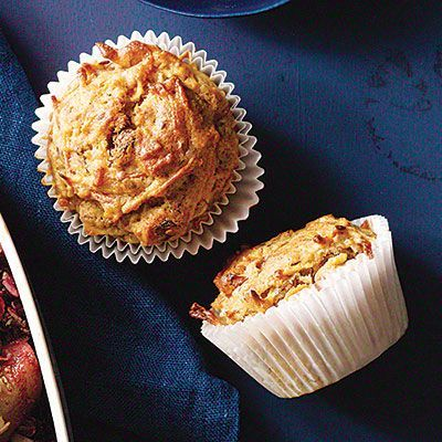 Carrot-Apple-Flax Muffins recipe for Thanksgiving: Leave the peels on the apples—the grated pieces won't affect the muffins' texture, plus you'll get fiber and cancer-fighting antioxidants. Health.com