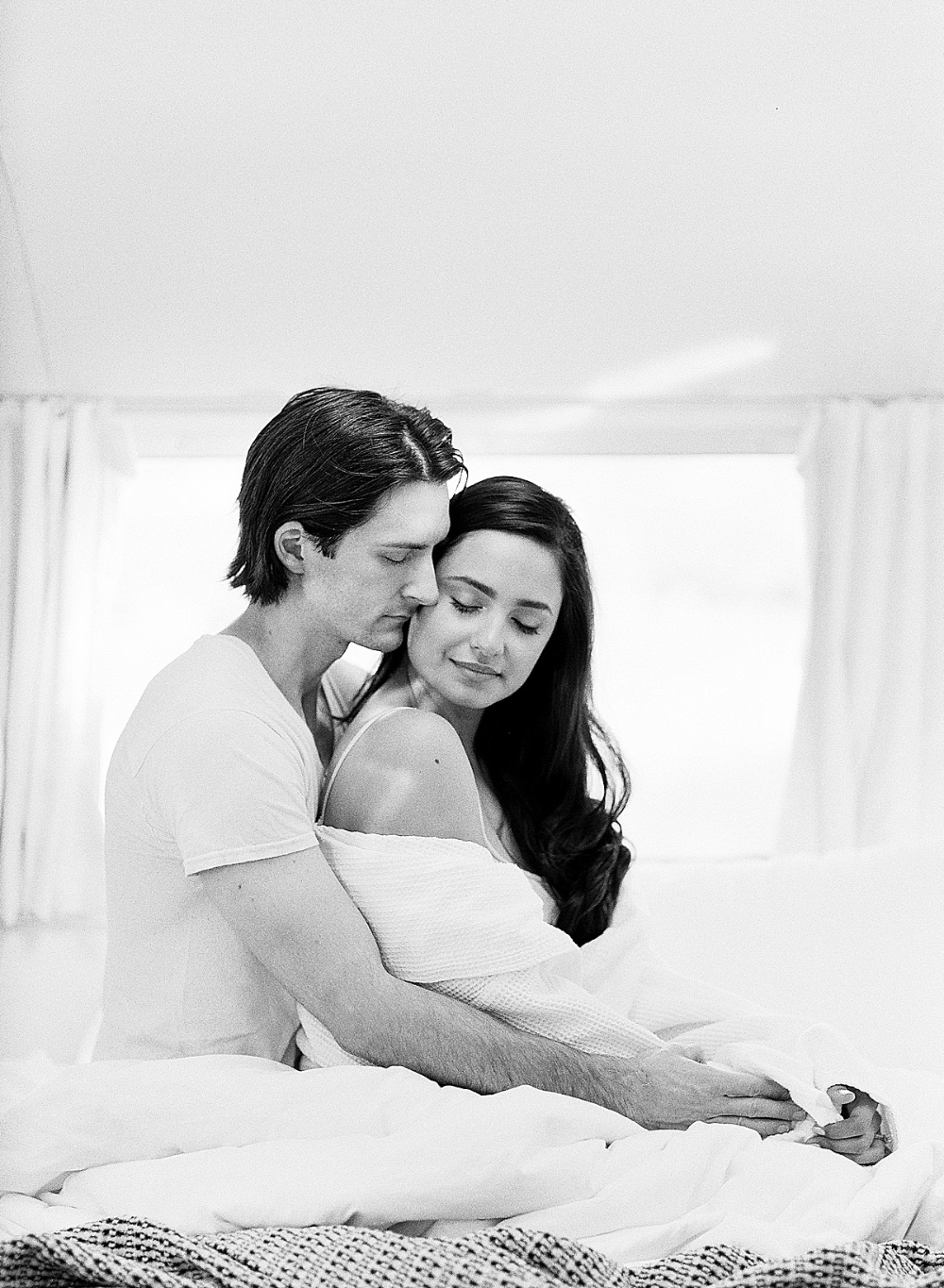 Black and White Portraits tell the emotional story a little better than color. The mood is more intense. You instantly see the couple's connection. #blackandwhite #lifestylesession #photography #engagementphotos