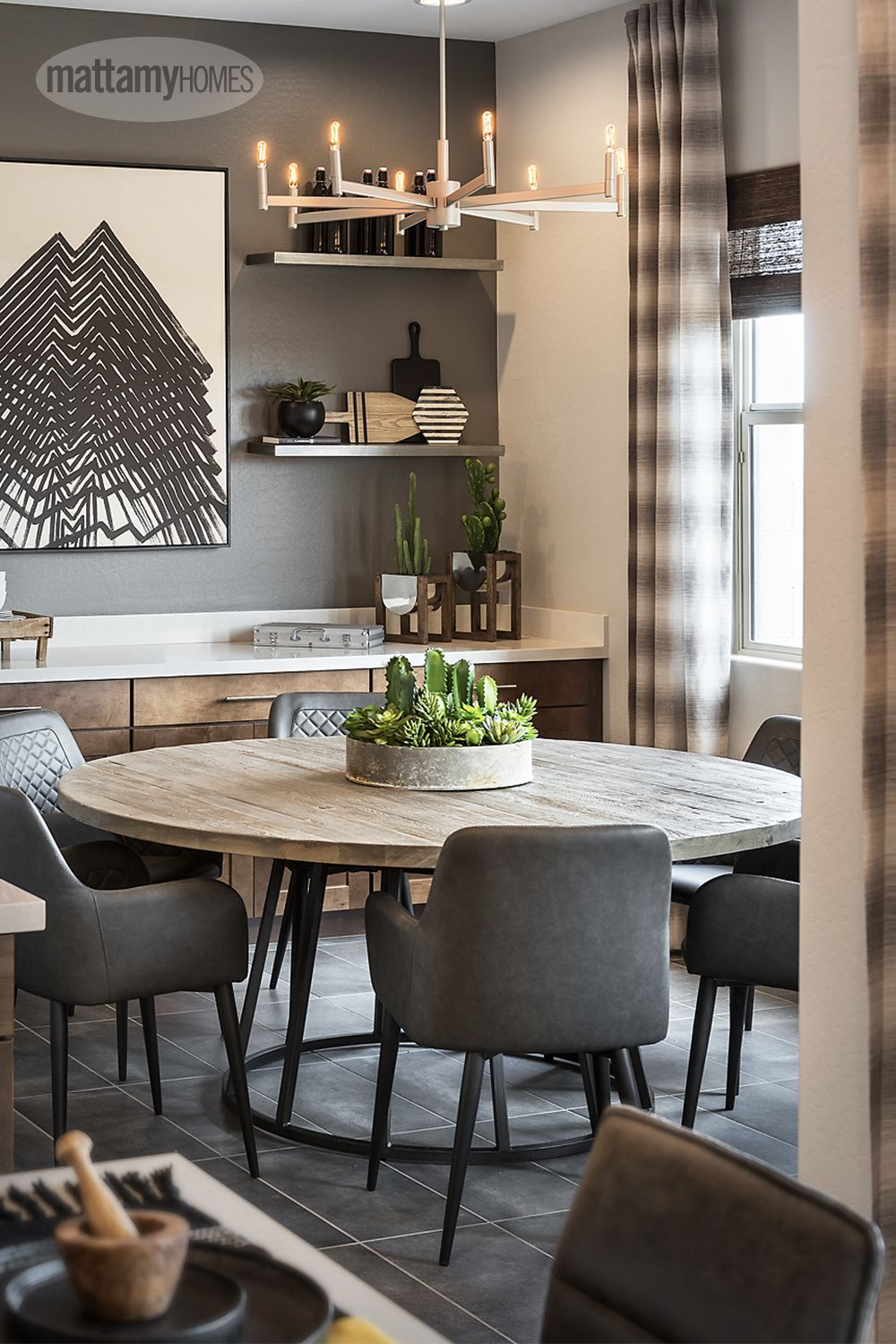 Let a stunning centrepiece take centre stage in your dining room. Hints of fresh greenery can tie the space together and add a little vibrancy to an industrial colour palette.nn#MattamyHomes #DiningRoom #DiningtableDecor #PlantDecor #HomeDecor