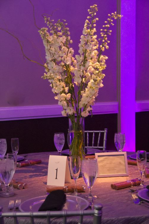Tall wedding centerpiece consisting of white delphinium