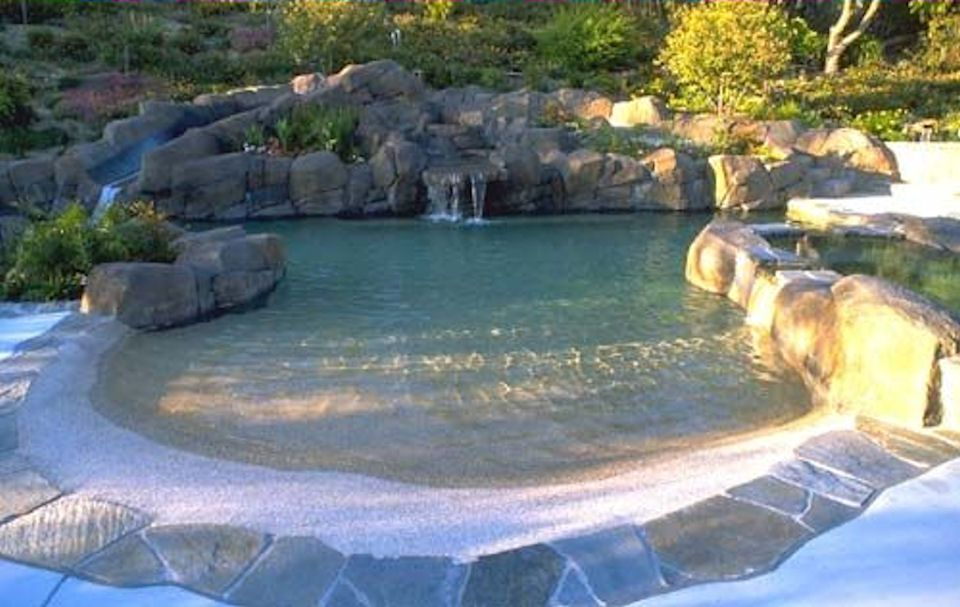 Beach Entry Lagoon Style Pool With Waterfall And Slide In Orlando