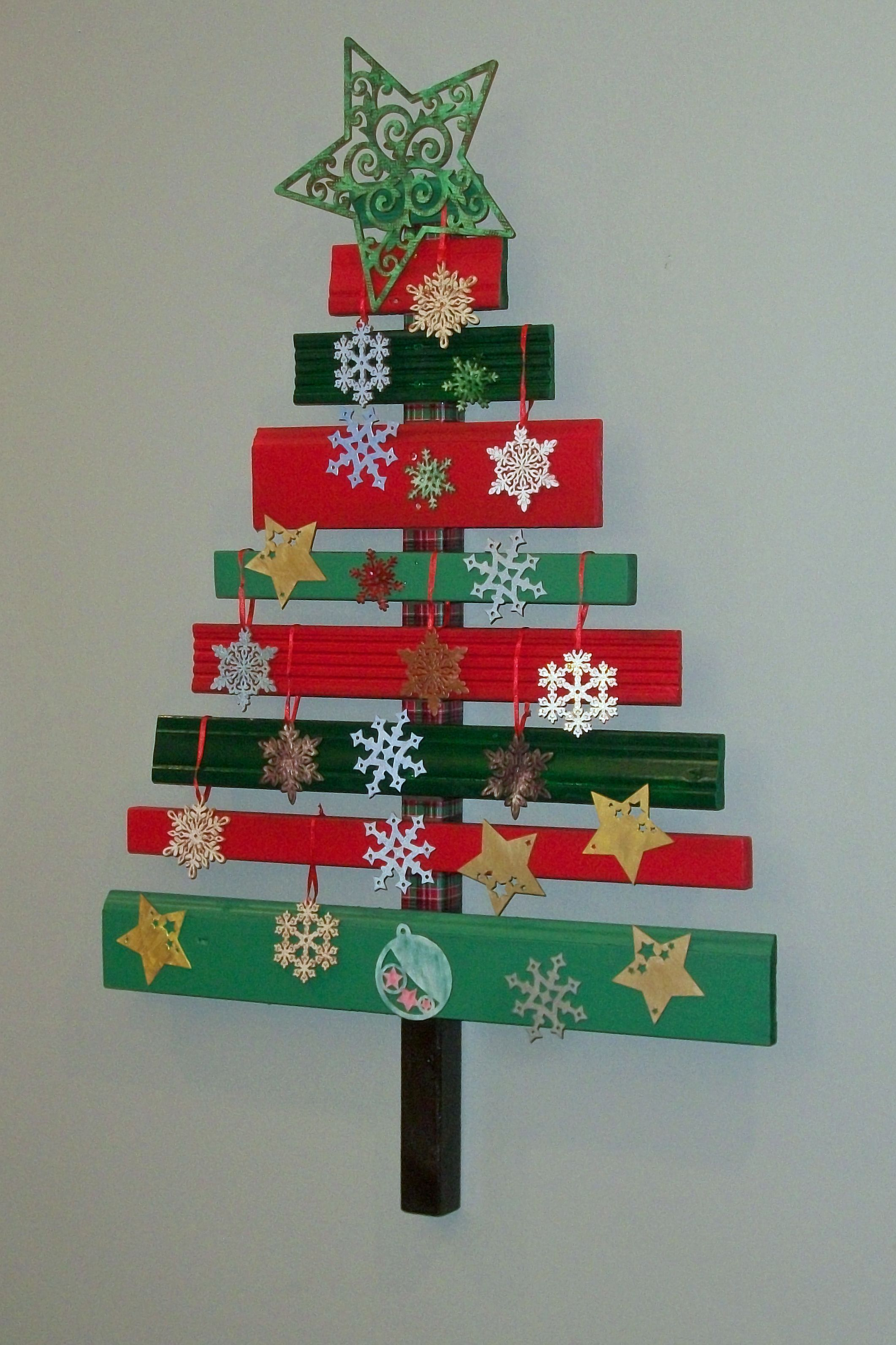 scrap wood christmas tree painted with acrylic paints decorated with random wood ornaments big star from michaels others from meijer and joanns