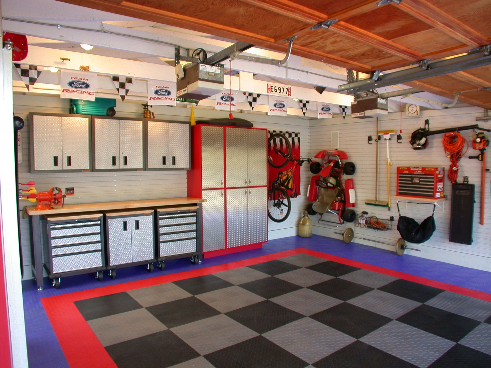 Cool garage by custom kitchens dream garage ideas for Cool garage designs