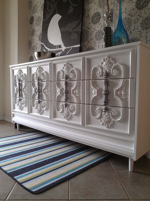 Ornate White Dresser to get a pewter type of look by spray painting