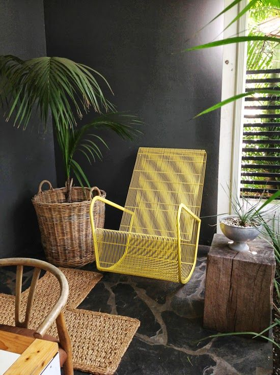 Yellow wire rocking chair at The Conceirge Boutique Bungalows, Durban South Africa