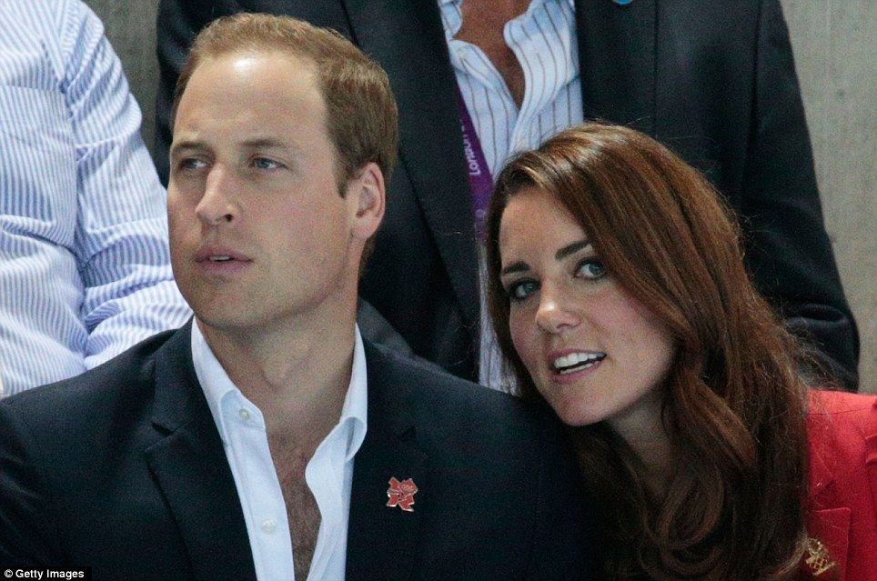 Kate and William keep a close eye on things at the Aquatics Centre as they cross their fingers for more GB gold