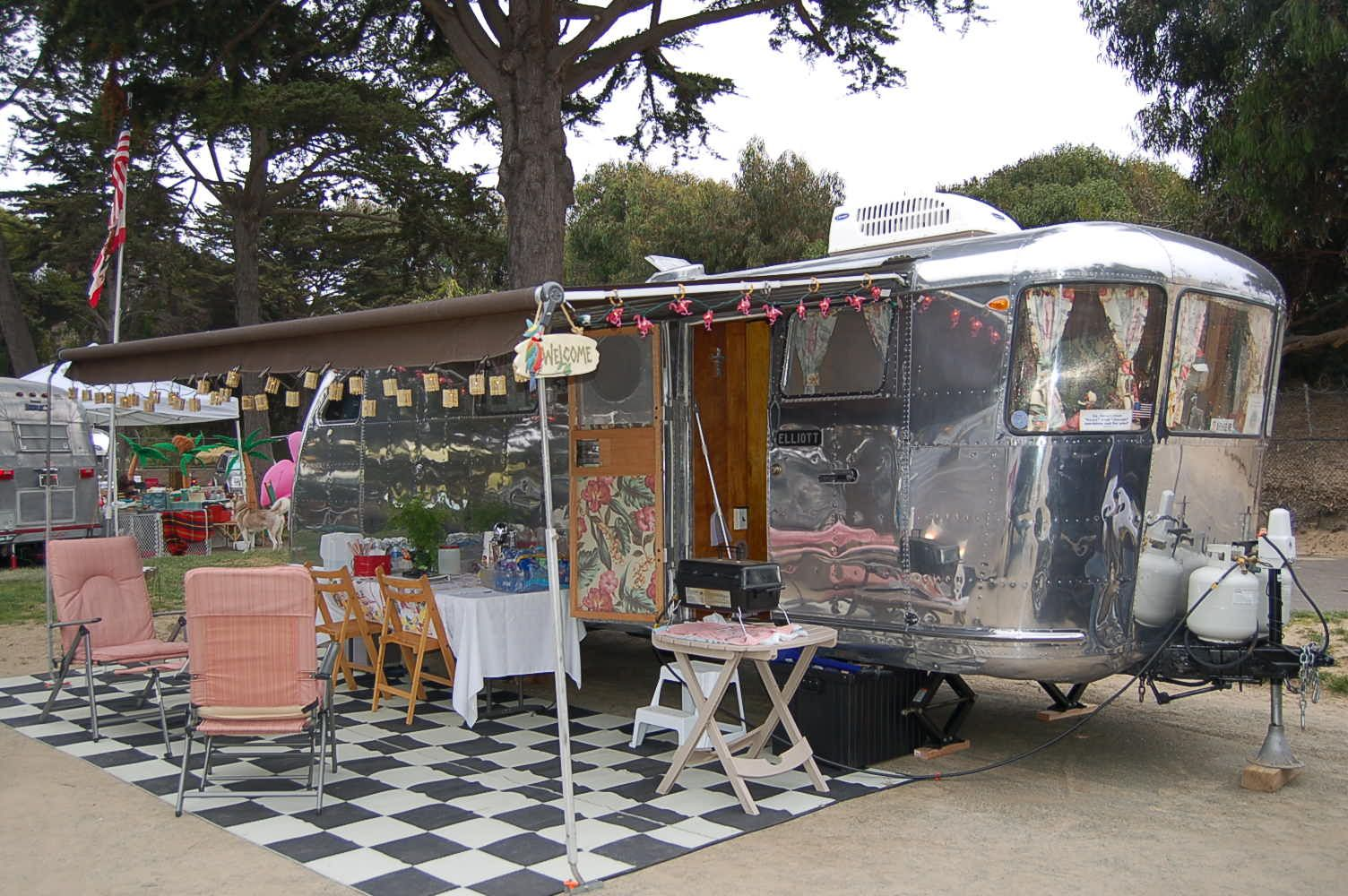 Vintage 1947 Spartan Manor Trailer With Large Awning Setup For Dinner Party Patio