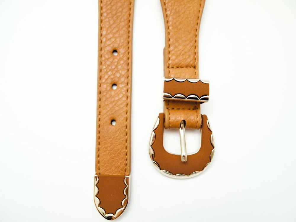 """""""Dex Salon"""" Goldielock Waist Belt is made with a matte leather look finish. Slim strap with a round, gold-tone edge keeper. Adjustable pin buckle fastening.."""