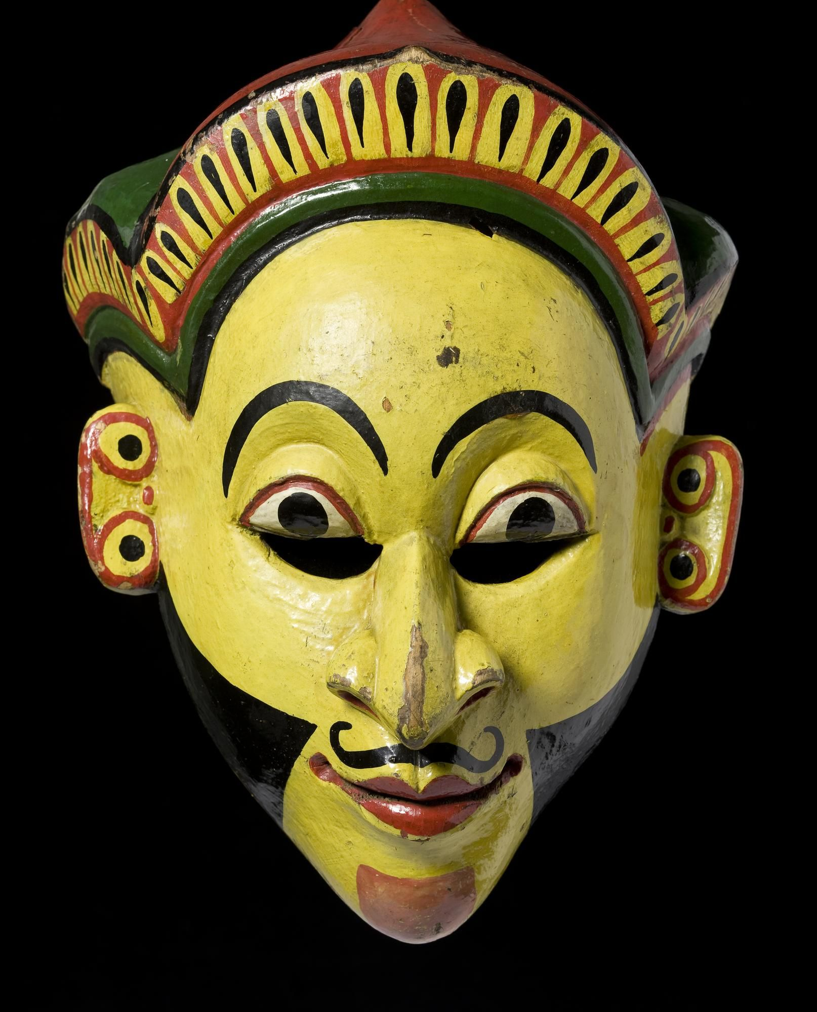 Mask used in the Sinhalese mask play, carved Kaduru wood