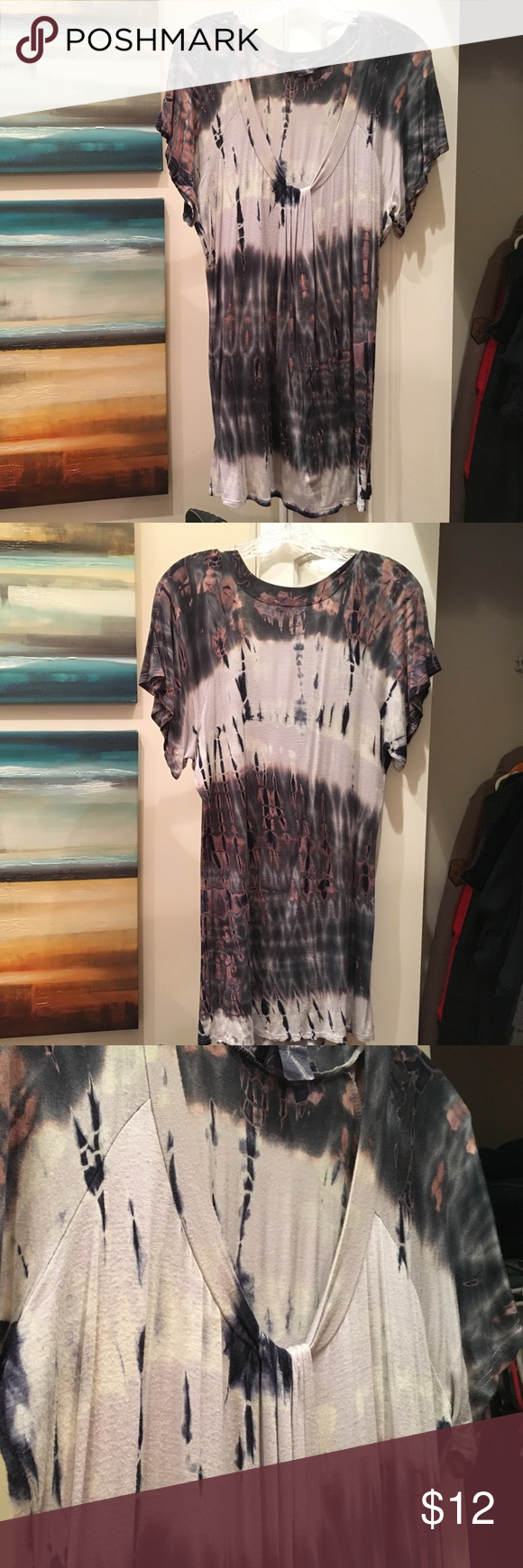 Daytrip Tie-Dye Shirt - XL This is a Daytrip tie-dye shirt bought from Buckle. I believe the material is 96% Rayon and 4% Spandex. Kind of hard to tell because of the tie-dye process. Almost a v-neck top with a ruching piece at the lower portion of the v-neck. Daytrip Tops Tees - Short Sleeve
