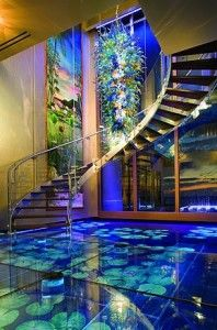 Acqua Liana glass water floor.  Stunning home. Would love to have elements of it within a smaller space. :) Lux to the max.